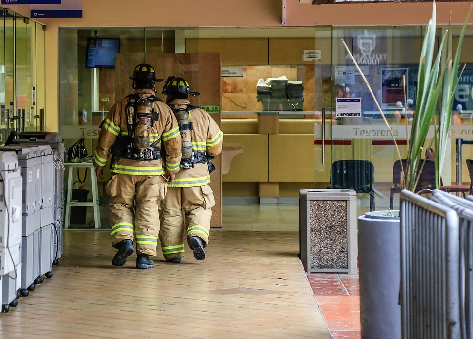 fire fighters in building